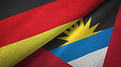 Antigua and Barbuda and Germany two flags together textile cloth, fabric texture