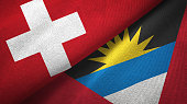 Antigua and Barbuda and Switzerland two flags together textile cloth, fabric texture
