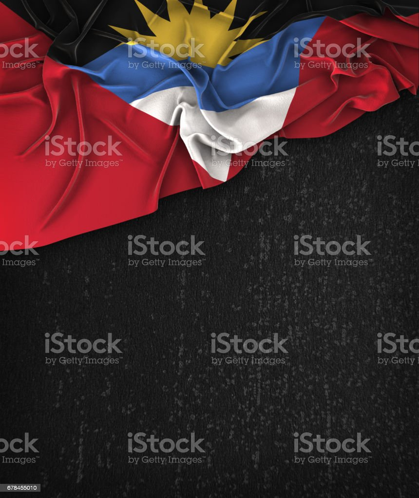 Antigua and Barbuda Flag Vintage on a Grunge Black Chalkboard With Space For Text stock photo