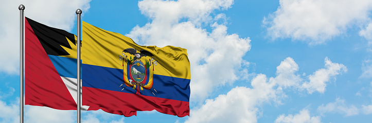 Antigua and Barbuda with Ecuador flag waving in the wind against white cloudy blue sky together. Diplomacy concept, international relations.