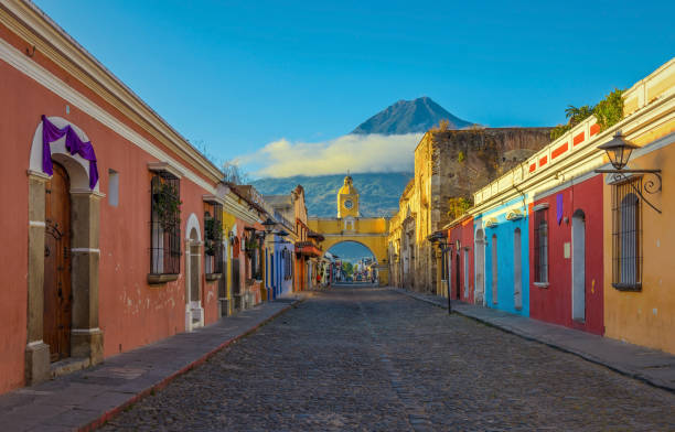 Antigua City at Sunrise The historic city of Antigua at sunrise with a view over the main street and the Catalina arch and the Agua volcano in the background, Guatemala. central america stock pictures, royalty-free photos & images