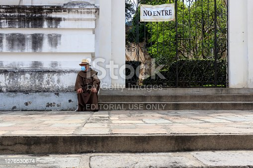 Antigua Guatemala, Sacatepequez/Guatemala - 09/22/2020 : Catholic Monk Sitting in front of Church San Francisco El Grande