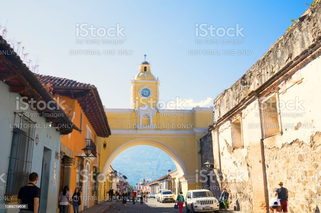 Antigua street view with famous arch and volcano view stock photo