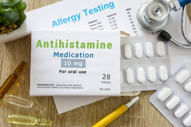 """Antihistamine medication or allergy drug concept photo. On doctor table is pack with word """"Antihistamine medication"""" and pills for treatment of allergy and hypersensitivity Antihistamine medication or allergy drug concept photo. On doctor table is pack with word """"Antihistamine medication"""" and pills for treatment of allergy and hypersensitivity antihistamine stock pictures, royalty-free photos & images"""