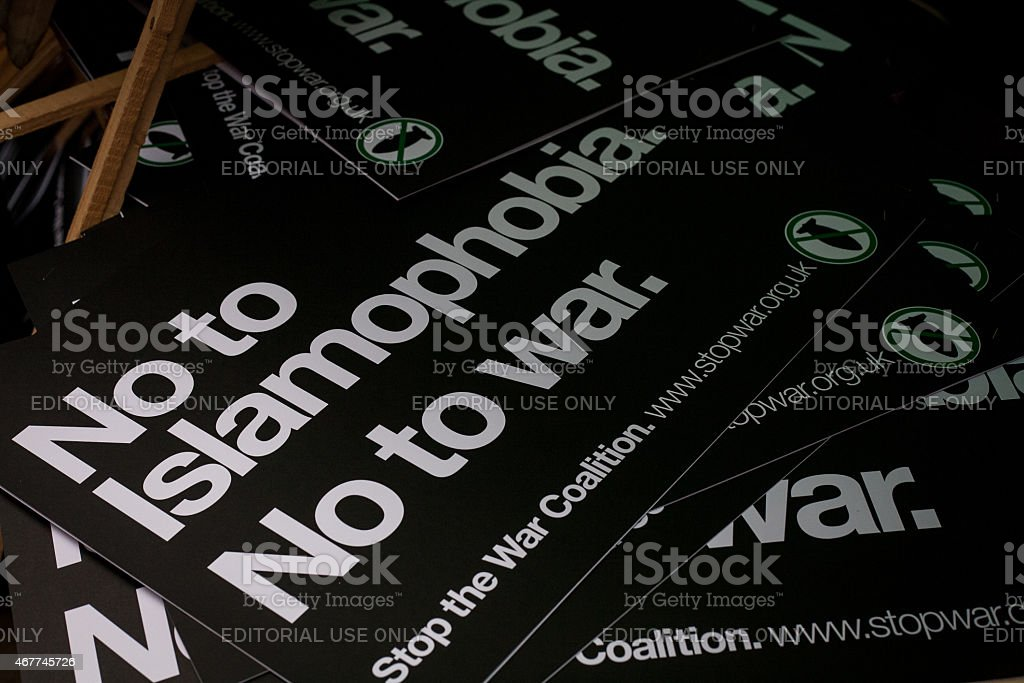 Anti-Islamophobia placards rest in a pile stock photo