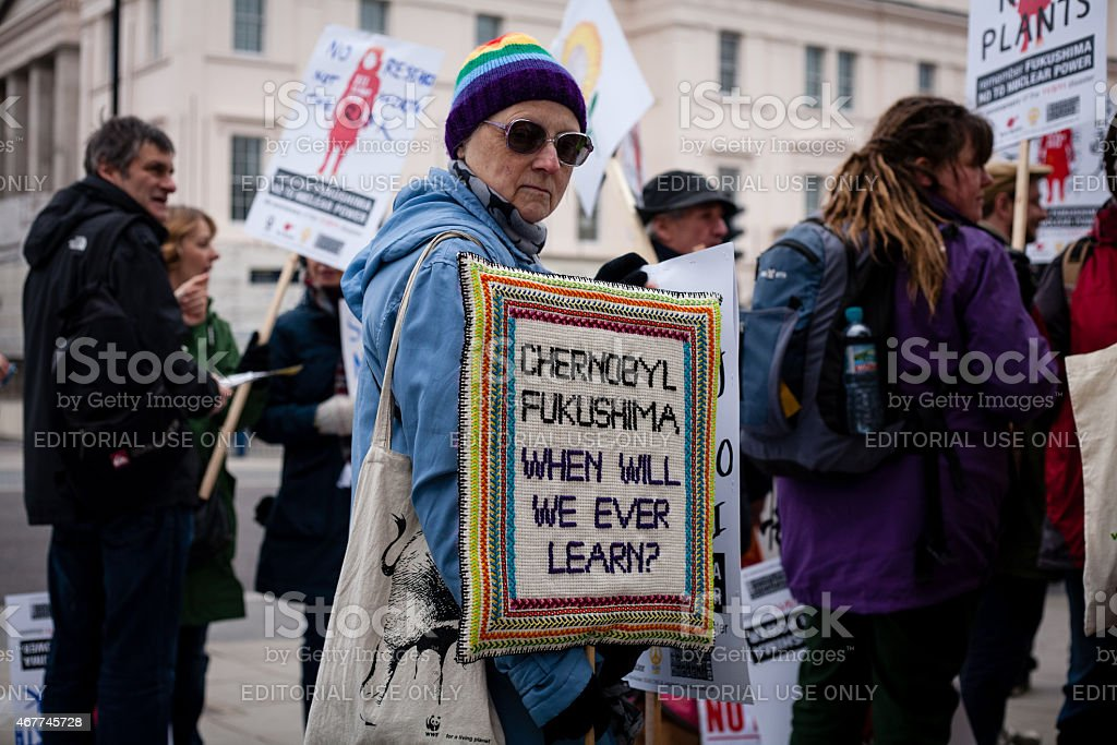 Anti-nuclear power activist holds handmade placard stock photo