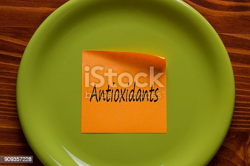 istock Antioxidants written on a note 909357228