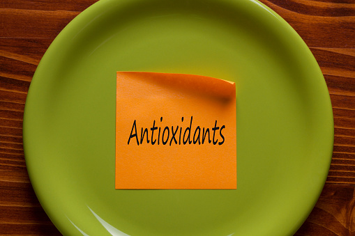 istock Antioxidants written on a note 909357228