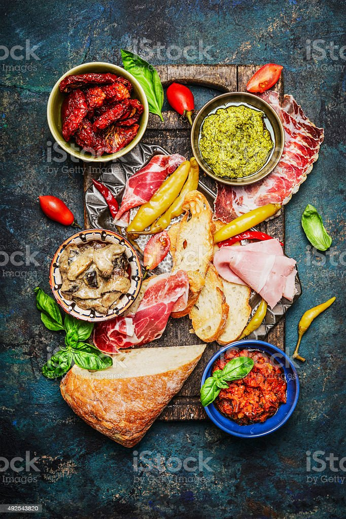 Antipasti ingredients  for  bruschetta or crostini making stock photo