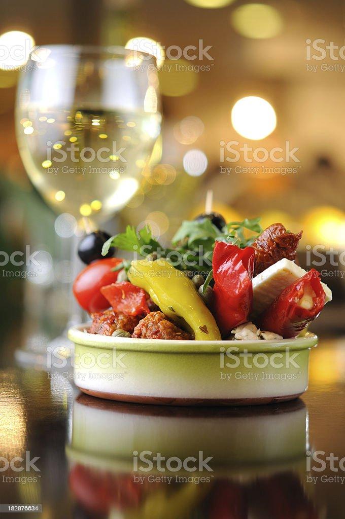 Antipasti with white wine royalty-free stock photo