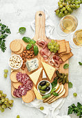 Antipasto board, flat lay composition  of summer light delicious snacks with wine