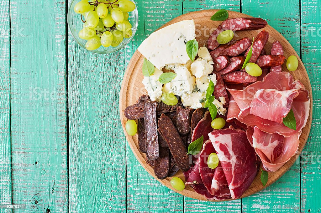 Antipasto catering platter with bacon, jerky, sausage, blue cheese stock photo