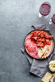 istock Antipasto. Meat platter, chips and sauces, red wine on gray background. Top view 1081735762