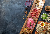istock Antipasto Platter. Ham serrano, salami olive jamon dip sauces and red wine 1081735336