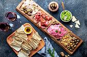 istock Antipasto Platter. Ham serrano, salami olive jamon dip sauces and red wine 1081735346
