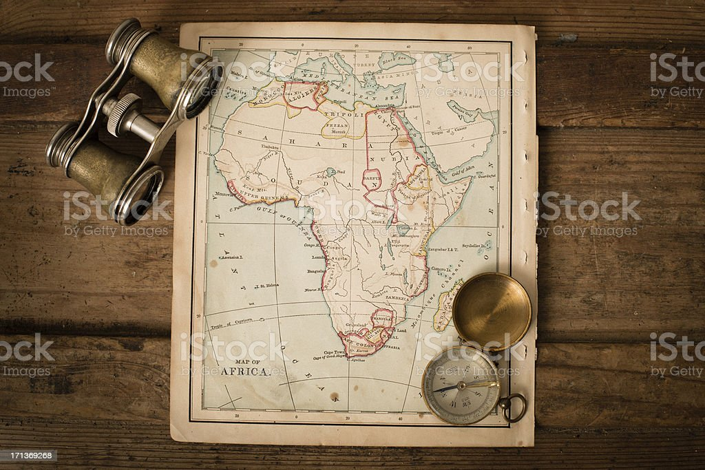Antique 1870 Map of Africa, Binoculars, and Compass on Trunk stock photo