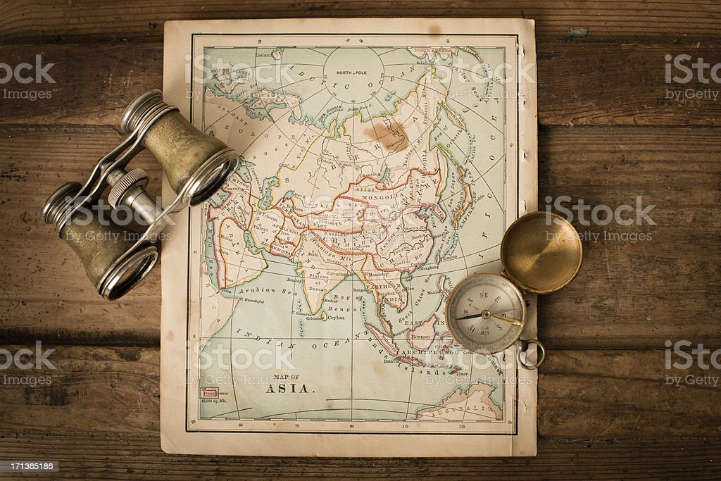 Antique 1870 Map of Asia, Binoculars, and Compass on Trunk royalty-free stock photo