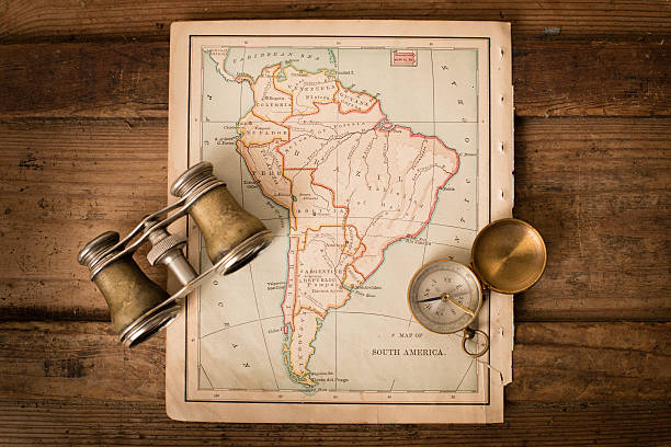 Antique 1870 Map of South America, Binoculars, and Compass stock photo