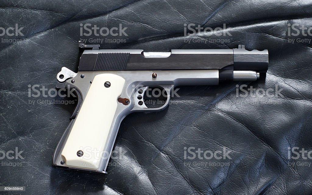 Antique 45 caliber 1911 pistol stock photo