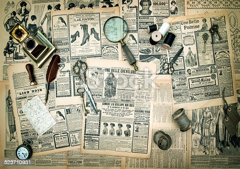 istock antique accessories, vintage fashion newspaper advertising 523710931