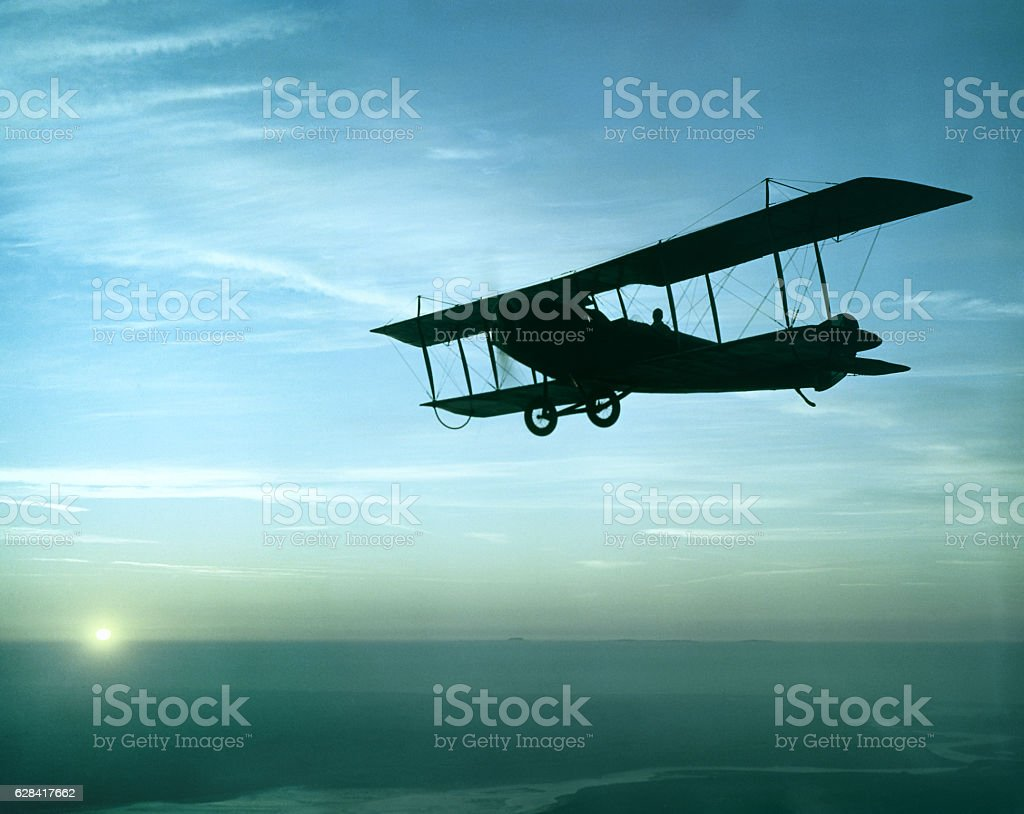 antique airplane flying at sunset, Standard J-1 - Photo
