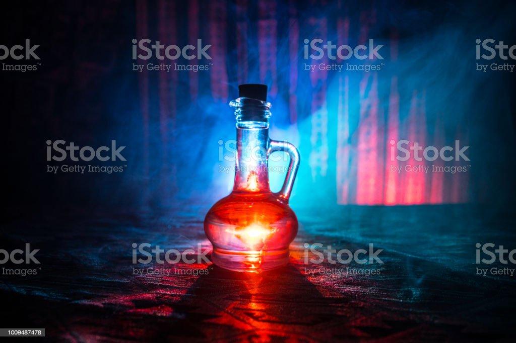 Antique And Vintage Glass Bottles On Dark Foggy Background