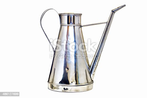 686515422istockphoto Antique arab teapot on a white background . 486127699