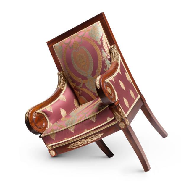 antieke fauteuil met gebroken been op witte achtergrond - gebroken stockfoto's en -beelden