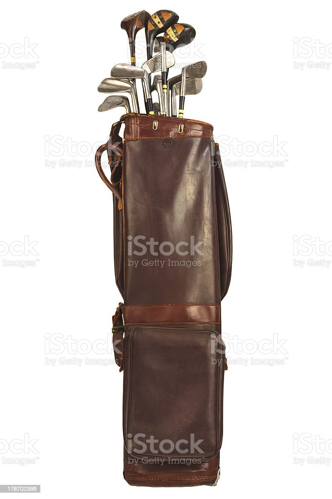 Antique bag with golf clubs isolated on white stock photo