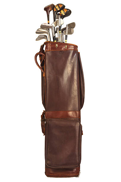 antique bag with golf clubs isolated on white - golf clubs stock photos and pictures