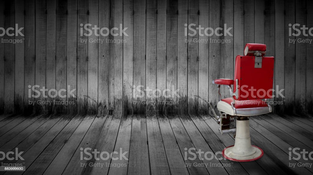 Antique barber chair in room (shop) stock photo