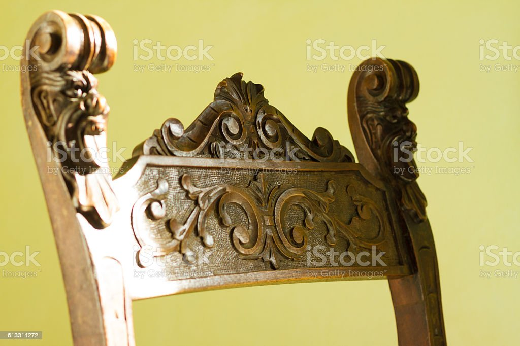Antique Baroque Carved Chair, Pale Green Background (Close-Up Detail) stock photo