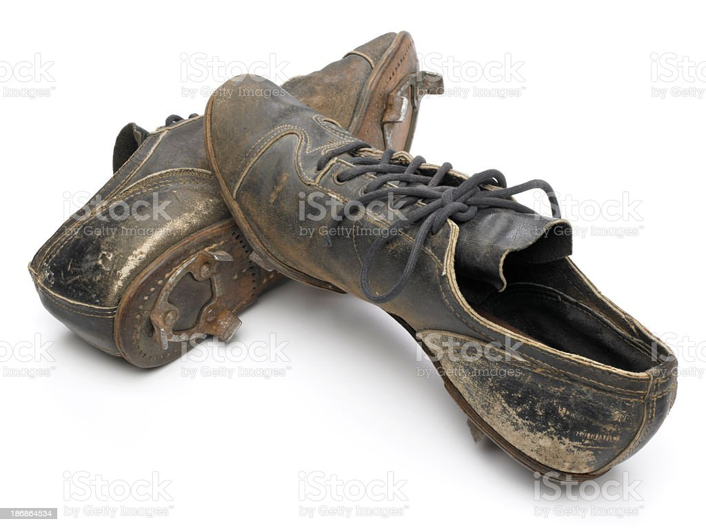 Antique baseball cleats on white background stock photo
