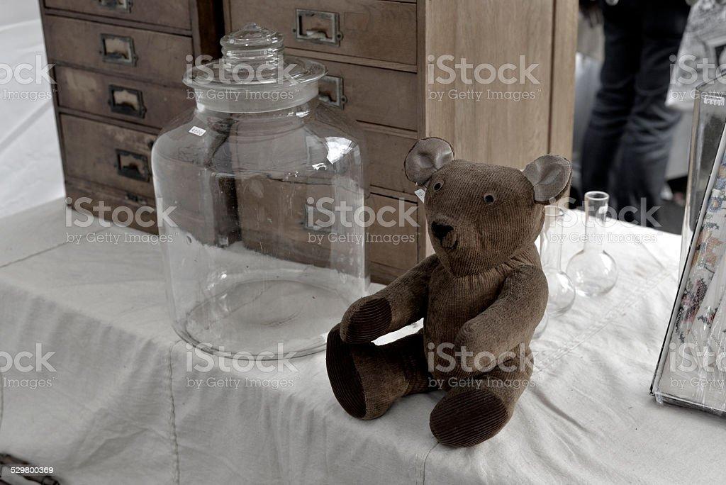 Antique bear and Bottle foto