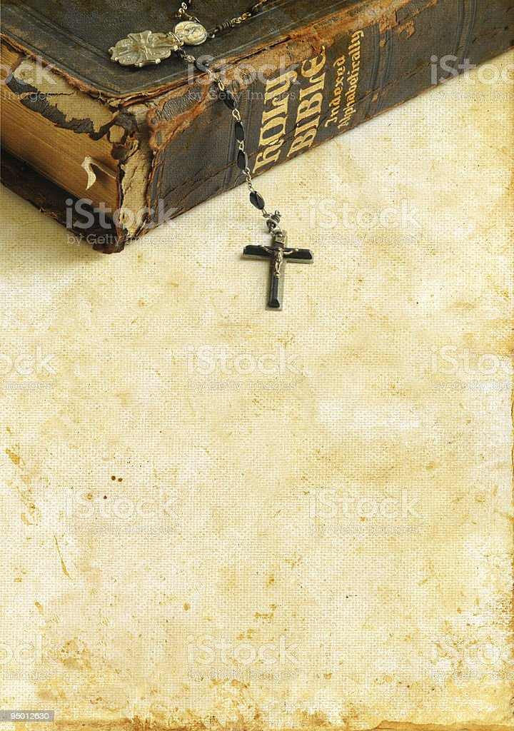 Antique Bible and Rosary on a Grunge Background royalty-free stock photo