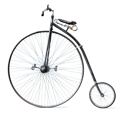 This is a photograph of a penny farthing bicycle isolated on a white background