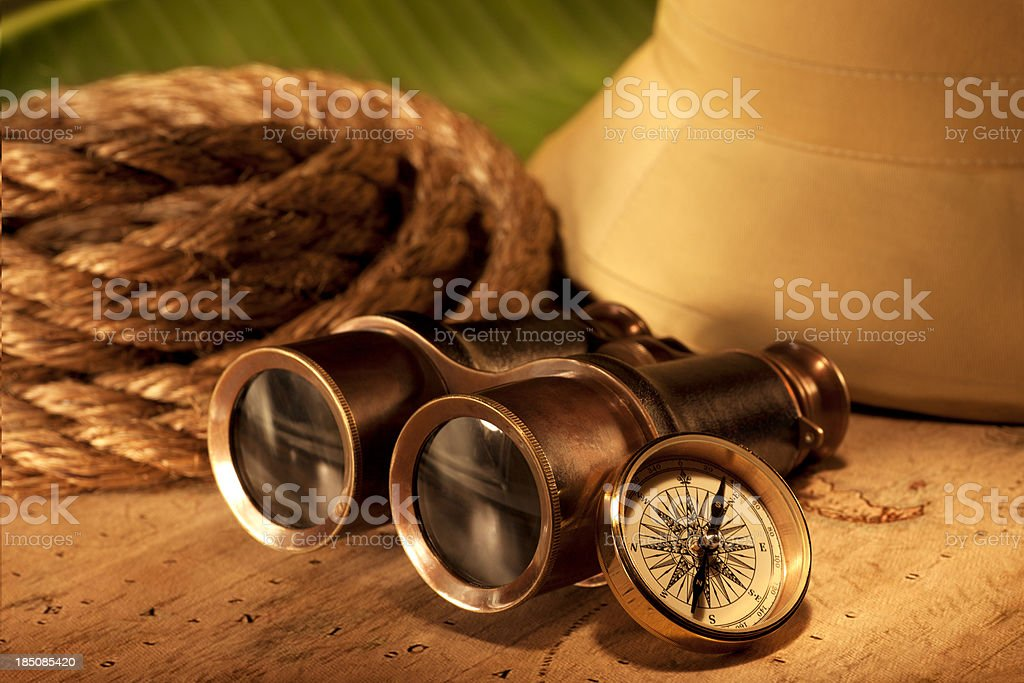 Antique Binoculars and Safari Hat with Rope stock photo