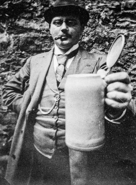 Antique black and white photo from German Photography Manual: Man with beer mug stock photo