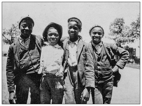 Antique black and white photo: Group of children in Southern USA