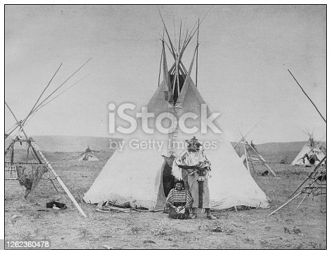 Antique black and white photo: Native encampment on the Sarcee Reserve