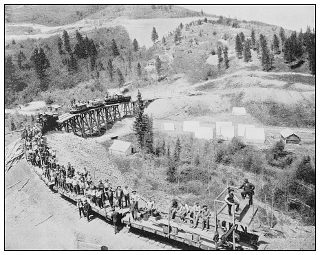 Antique black and white photo of the United States: Railroad building in the black hills