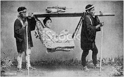 Antique black and white photo of travel around the World: Kago, Japanese Traveling Chair