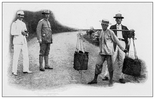 Antique black and white photograph of people from islands in the Caribbean and in the Pacific Ocean; Cuba, Hawaii, Philippines and others: Chinese farmer carrying products to market, Hawaii