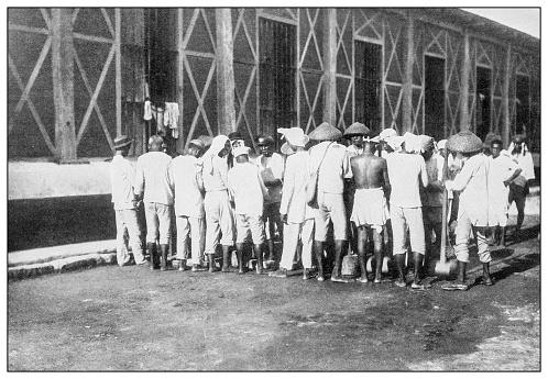 "Antique black and white photograph: Filipino ""pound party"" prisoners"