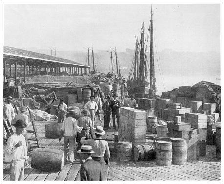Antique black and white photograph of people from islands in the Caribbean and in the Pacific Ocean; Cuba, Hawaii, Philippines and others: Havana docks, Cuba