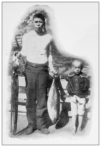 Antique black and white photograph of people from islands in the Caribbean and in the Pacific Ocean; Cuba, Hawaii, Philippines and others: Japanese fisherman and his son, Hawaii
