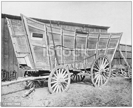 Antique black and white photograph of American landmarks: A Prairie Schooner