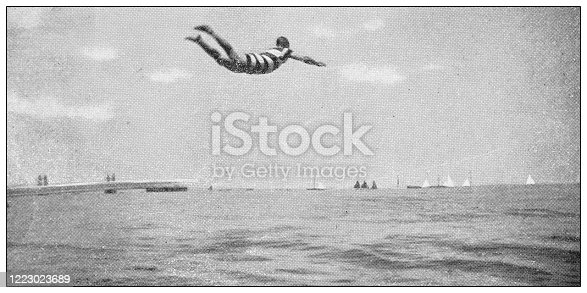 Antique black and white photograph of sport, athletes and leisure activities in the 19th century: Spring-board diving