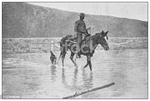 658114236 istock photo Antique black and white photograph of sport, athletes and leisure activities in the 19th century: Bighorn hunting in Canada, Rocky mountains 1223396382