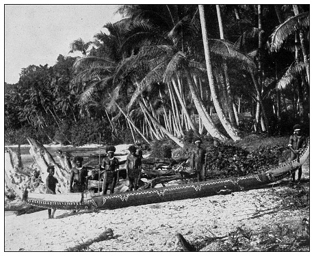 Antique black and white photograph of people from islands in the Caribbean and in the Pacific Ocean; Cuba, Hawaii, Philippines and others: Papuan war canoe